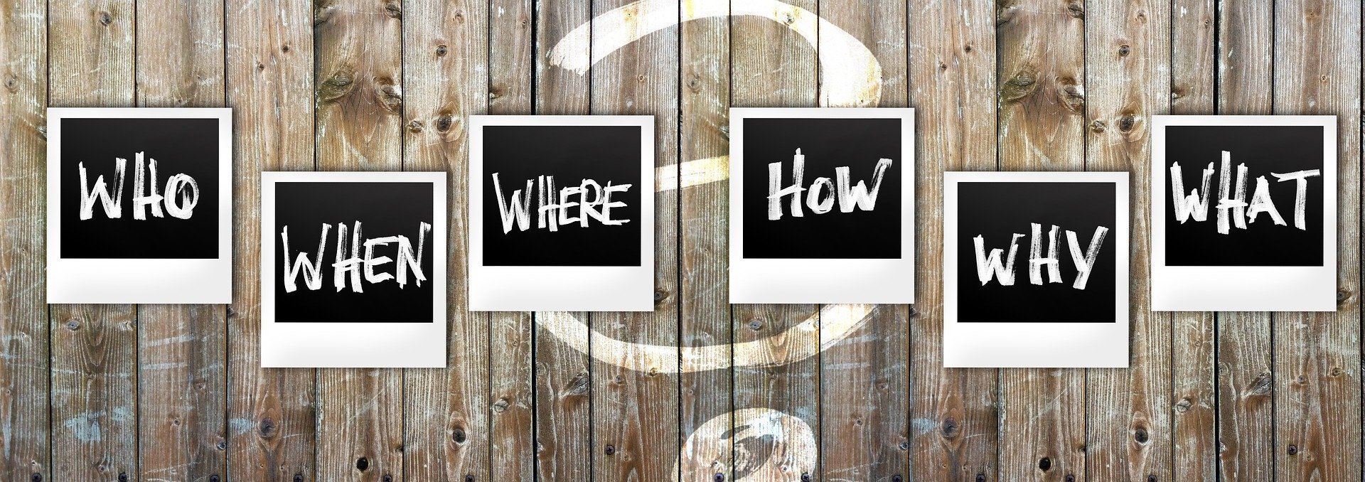 "Image of signs that read ""who,"" ""what,"" ""where,"" and ""how,"""