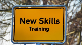 """Image of a sign that reads """"New Skills Training."""""""