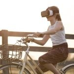 Child riding bike wearing augmented reality goggles